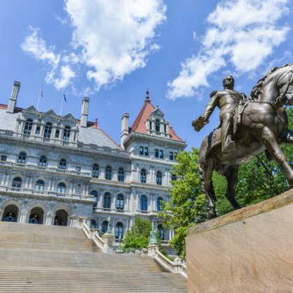 The New York State Capitol Building in Albany, home of the New York State Assembly. Monument of General Sherman on horseback.